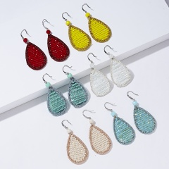 Geometric drop woven earrings 1