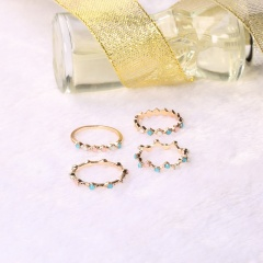 4 sets of colored wavy diamond studded knuckle rings Colour
