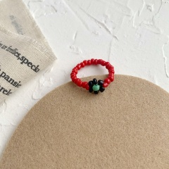 The floret stretch hand woven ring Red