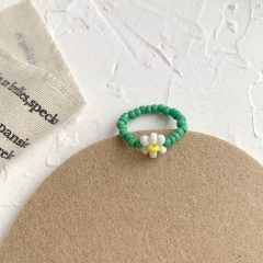 The floret stretch hand woven ring Green