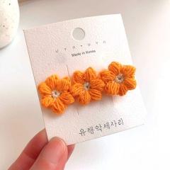 Yarn Daisy Flower Flowing Sea Clip Hairpin Wholesale Orange & Beige
