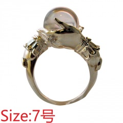 Holding a white bead vintage ring #7