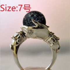 Holding a black bead vintage ring #7