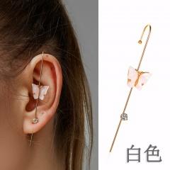 Butterfly inlaid rhinestone diagonal pierced copper earrings white